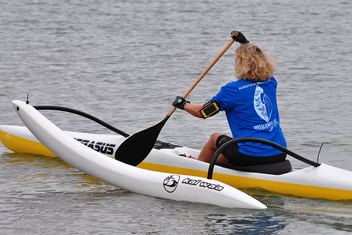 Linda Sherman in her OC-1 (one man outrigger canoe) photo by Ray Gordon