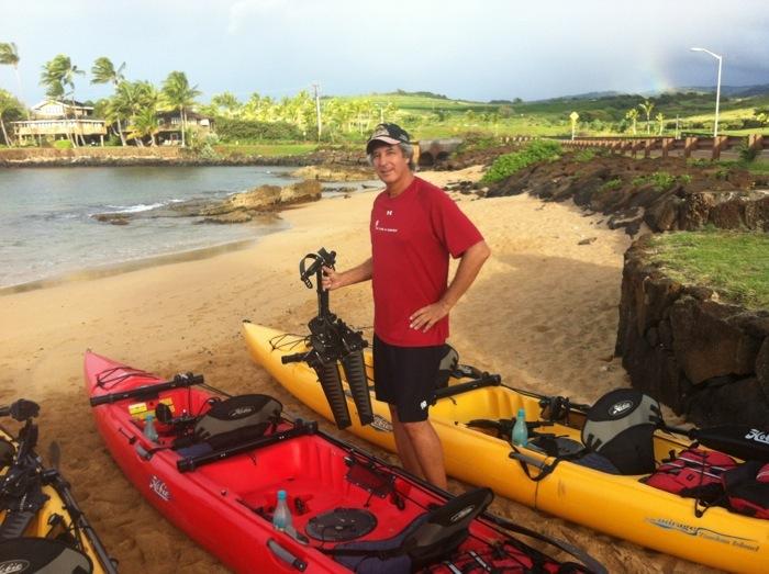 Ray Gordon holding Hobie kayak peddle