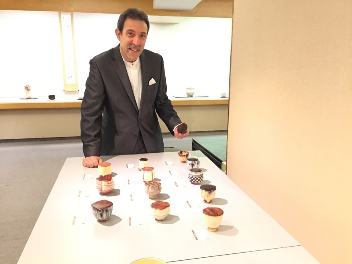Richard Milgrim with some of his chaki or tea containers with lids