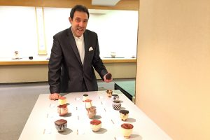 Richard Milgrim with some of his tea bowls (chawan) with lids